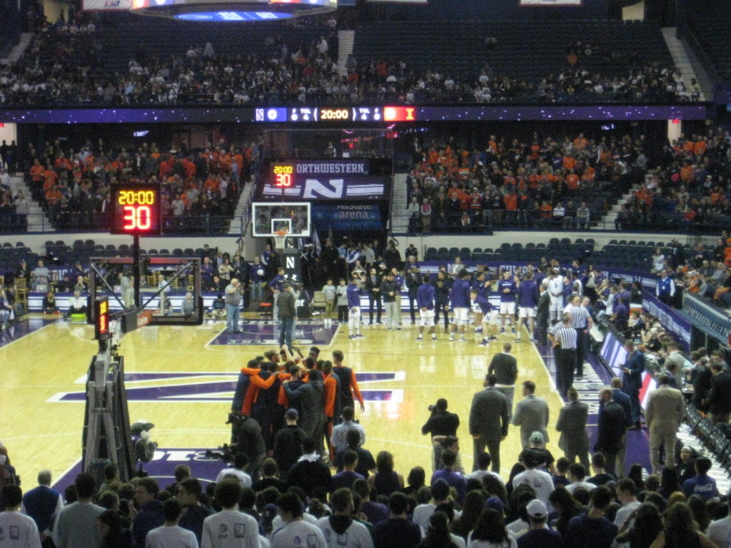 Northwestern Illinois basketball pre-game huddle